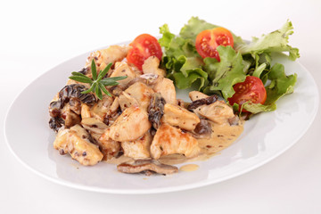 grilled meat with cream and mushrooms