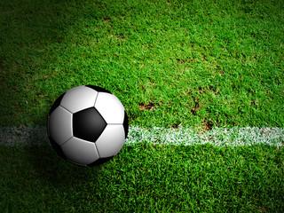 Football ( soccer ball ) in green grass field.