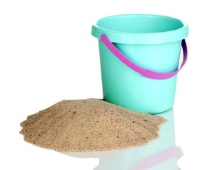 Children's bucket and sand isolated on white