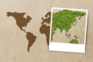 frame photo eco world map on wood texture