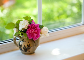 beautiful bouquet of roses on a window sill