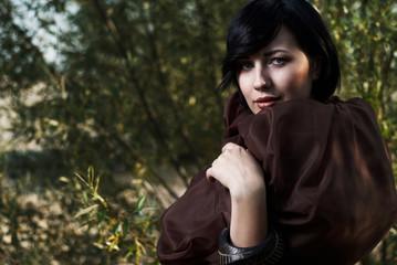 girl posing in a tree shade