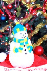 Snowman decoration under Christmas tree