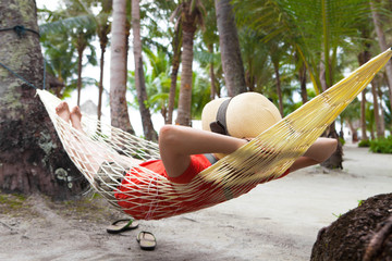 woman on hammock at sea beach