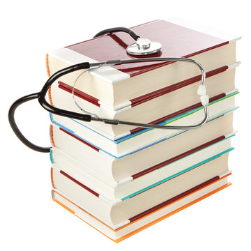 stack of books and a stethoscope. On a white background.