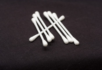 Cotton sticks isolated on black background
