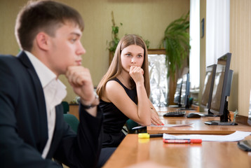 Portrait of beautiful girl at office of boss looking at work