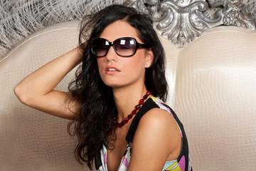 Elegant brunette woman in sun glasses
