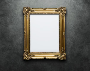 Ornate gold frame at the concrete wall with clipping path