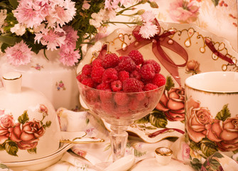 Vintage elegant teacups, raspberry and flowers