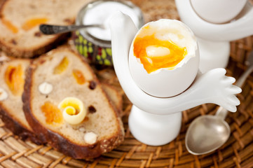 Boiled egg and whole grain bread with nuts and fruit