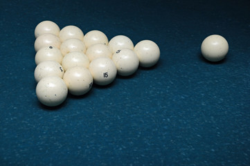 Fifteen white billiard spheres on a green table