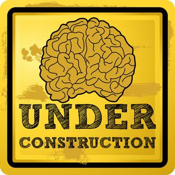 Grunge under construction human brain vector illustration