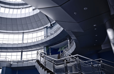 staircase and balconies in an interior of a modern building