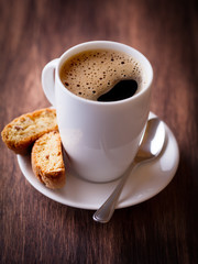 Cup of delicious coffee and cantuccini