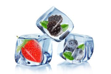 Foto op Canvas In het ijs Fruit in ice cubes over white