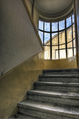 Stairwell in an abandoned industrial building