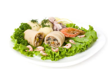 Squid stuffed with shrimp and vegetables on salad leaf