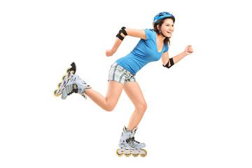 Full length portrait a smiling girl on rollers skating