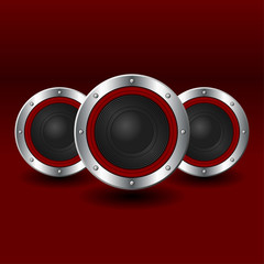 Speakers set with shadows over red background