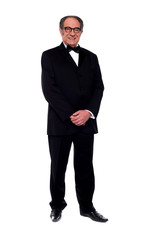 Attractive senior man posing in tuxedo