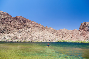 A man kayaking in Lake Mead