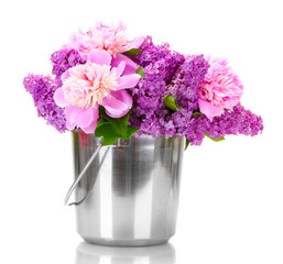 beautiful lilac and peonies flowers in metal bucket isolated