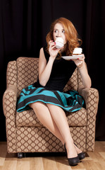 Redhead girl secretly eating cake.