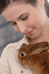 Young woman with domestic rabbit