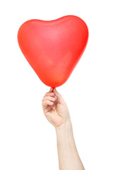 Hand hold  balloon in the shape of heart