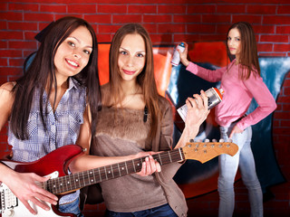 Group people with guitar.