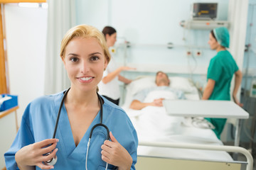 Blonde nurse looking at camera while smiling