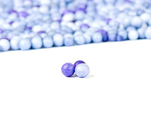 One blue and two violet little pearls