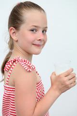 a little girl with a milk mustache