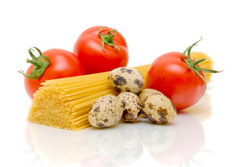 spaghetti, quail eggs and tomatoes on a white background