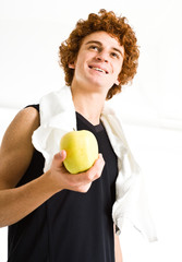 Healthy man holding an apple