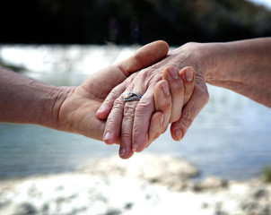 Young hand supporting old hand-helping elderly people concept