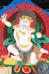 Ancient Tibetan wall painting art of buddha