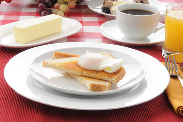 Poached egg breakfast on toast with coffee