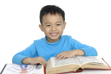 Adorable boy studying a over white background
