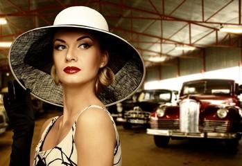 Woman in hat in retro garage