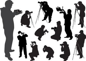 twelve photographers isolated on white