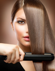 Wall Mural - Hairstyling.Hairdressing.Hair Straightening Irons.Straight Hair