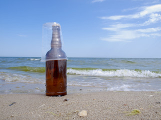 bottle and plastic glass