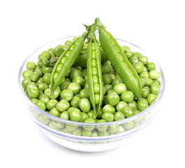 fresh green peas in a bowl  isolated on a white background