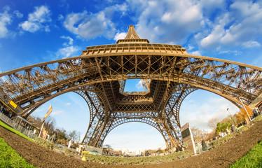 Fototapete - Wide angle upward view of Eiffel Tower in Paris