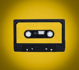 Retro cassete on yellow background
