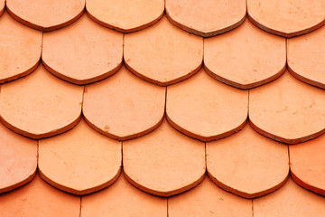 Detail of a house red roof tiles.