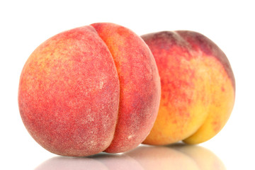 ripe peaches isolated on white.