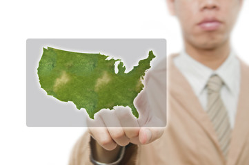 Businessman point finger on america map with embeded flag